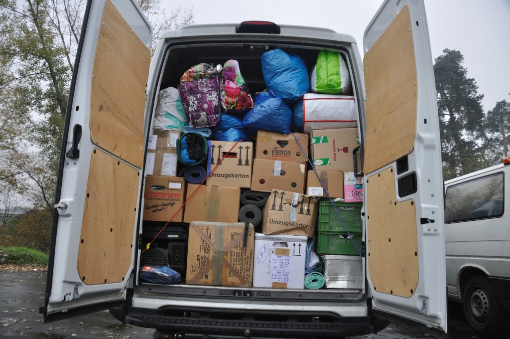 our car full of donations - we were a tiny bit proud of how professional it looks