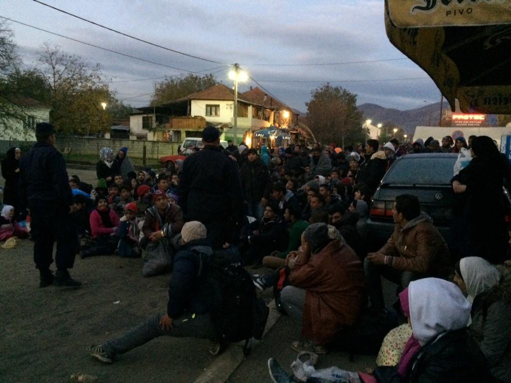 People are being forced to sit on the ground at night in the line while police forces struggle to manage the crowd