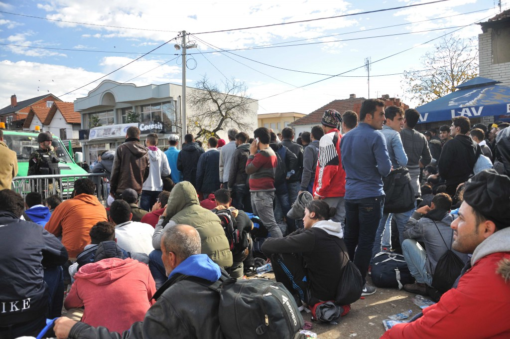 Refugees need to sit down to wait behind the lattices