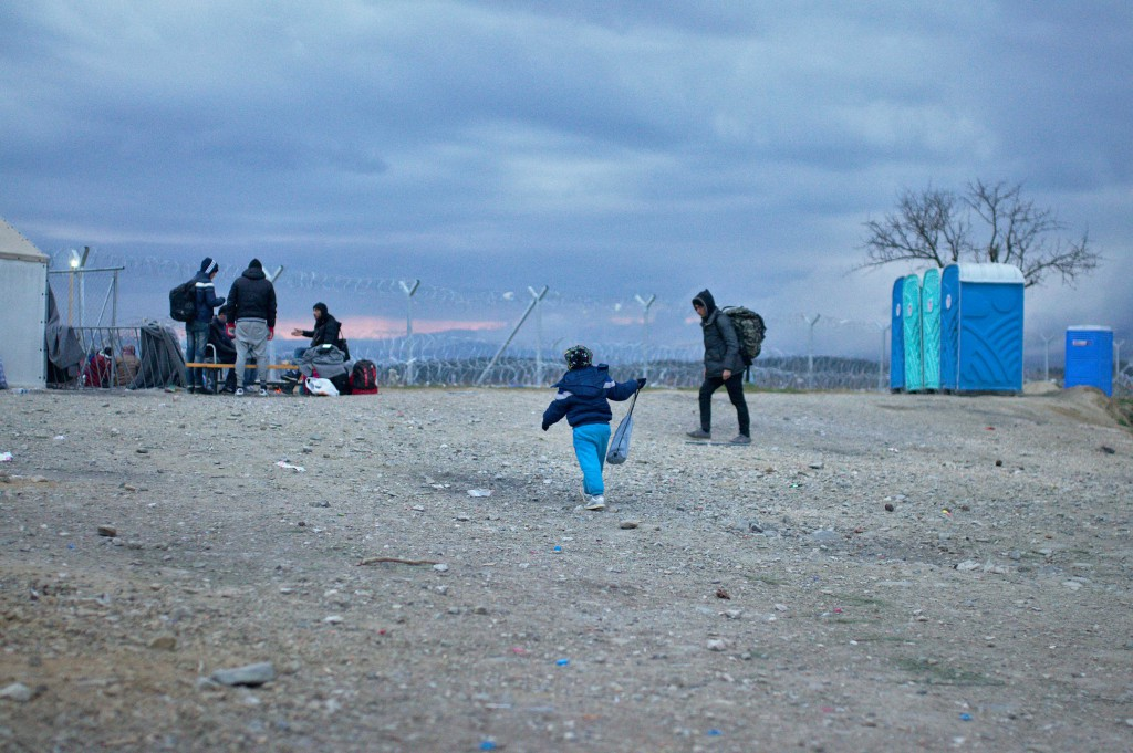 Refugee child in front of the border crossing